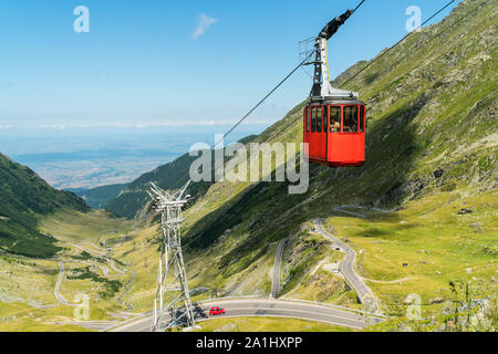 Сable car to Balea Lake and a view on a famous Transfagarasan Road in Romanian Carpathian Moutains - Stock Photo