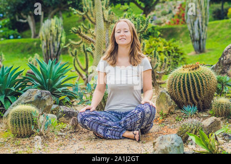 A young woman is meditating among a cactus. Spiny concept. Out of comfort zone concept..