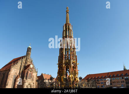 Our Lady's church (Frauenkirche) and Schöner Brunnen fountain (beautiful fountain) at the Nürnberg Hauptmarkt (central square) in Nuremberg, Bavaria, - Stock Photo