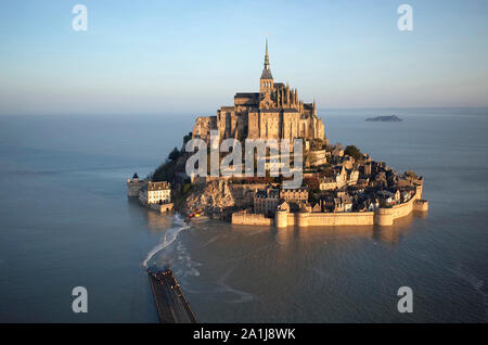 Le Mont Saint-Michel (St Michael's Mount) in Normandy, north-western France, on 2019/02/22: aerial view of the mount surrounded by water during a spri