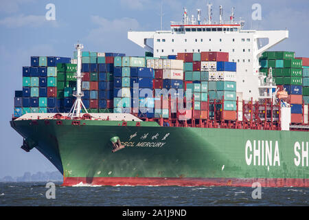 Cuxhaven, GERMANY - June 14, 2014:  CSCL-Star-Typs Containership. Ultra Large Container Ship (ULCS) on its way to Bremerhaven. Passing by 'Alte Liebe' - Stock Photo