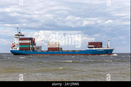 Cuxhaven, GERMANY - June 14, 2014: Containership coming from Bremerhaven shipping goods to Rotterdam. - Stock Photo