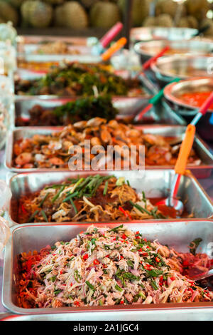 Freshly prepared dishes, ready to serve at the local market in Pakse, Laos - Stock Photo