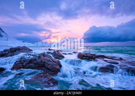 Norwegian Sea waves on rocky coast of Lofoten islands, Norway - Stock Photo