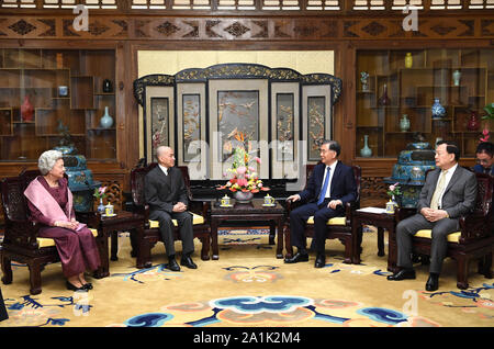 Beijing, China. 27th Sep, 2019. Wang Yang, chairman of the National Committee of the Chinese People's Political Consultative Conference (CPPCC), meets with Cambodian King Norodom Sihamoni and Queen Mother Norodom Monineath Sihanouk at the Diaoyutai State Guesthouse in Beijing, capital of China, Sept. 27, 2019. Credit: Rao Aimin/Xinhua/Alamy Live News - Stock Photo