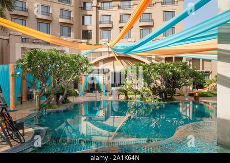 Modern swimming pool at the Radisson Blu Plaza Hotel at Mahipalpur near Delhi Airport in New Delhi, capital city of India Stock Photo
