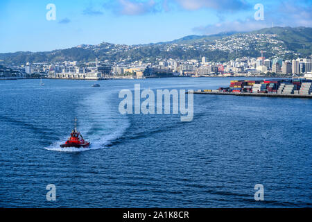 The port of Wellington, New Zealand, with quay and cargo hub on right and Lambton Harbour and the city centre beyond. - Stock Photo