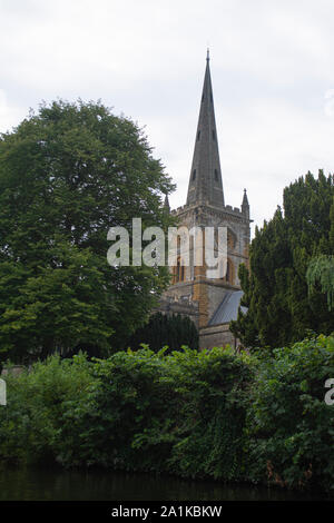 Holy Trinity Church viewed from the River Avon in Stratford-Upon-Avon UK - Stock Photo