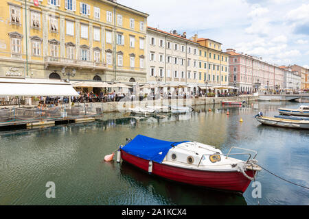 JULY 22, 2019 - TRIESTE, ITALY - Canal Grande, the Grand Canal, is a navigable canal that crosses the historical center of Trieste and reaches the sea - Stock Photo