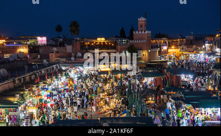 People in Jemaa el-Fna square at dusk, Marrakech, Morocco, North Africa - Stock Photo