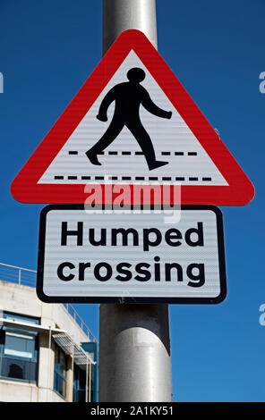 A sign warning of a humped zebra crossing in Weston-super-Mare, UK. - Stock Photo