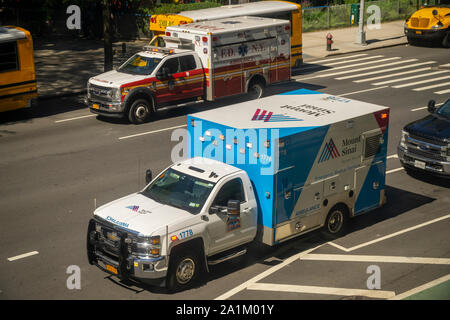 Mt. Sinai and an NYFD ambulances parked on calls in the Chelsea neighborhood of New York on Thursday, September 19, 2019. (© Richard B. Levine) - Stock Photo
