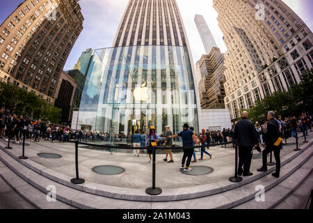Customers enter the newly opened Apple store on Fifth Avenue in New York on opening day on Friday, September 20, 2019.  The new iPhones, the iPhone 11, iPhone 11 Pro and the iPhone 11 Max , anxiously awaited by drooling iPhone aficionados, sell between $699 and up to $1449 depending on the model and storage choices.  (© Richard B. Levine) - Stock Photo