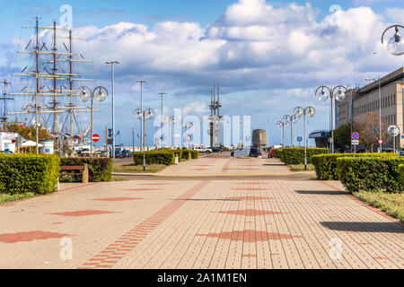 View at two monuments located on South Pier in Gdynia, Poland. Monument to Polish writer Joseph Conrad and 25 meters high steel units Three Masts monu - Stock Photo