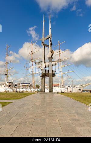 View at 25 meters high steel units Three Masts monument in memory of people who died at sea, located on South Pier in Gdynia, Poland. - Stock Photo