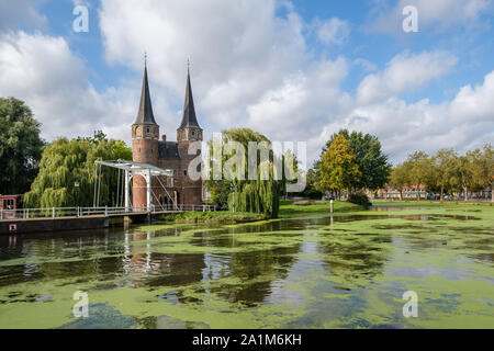 Historical Eastern Gate and drawbridge over the canal in Delft, Netherlands. This gate build around 1400 is the only remaining city gate of Delft.