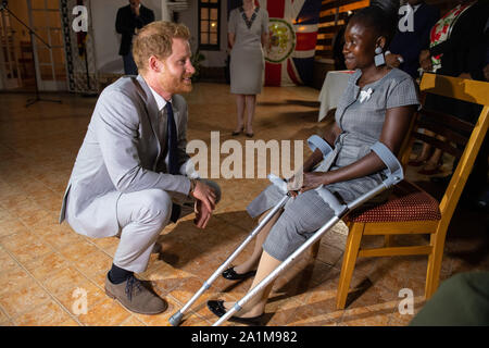 The Duke of Sussex meets landmine victim Sandra Tigica, who Princess Diana met on her visit to Angola 1997, during a reception at the British Ambassadors Residence in Luanda, Angola, on day five of the royal tour of Africa. - Stock Photo