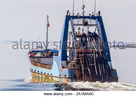 New Bedford, Massachusetts, USA – July 26, 2019: Clammer Sea Watcher I, hailing port Atlantic City, New Jersey, leaving New Bedford on hazy morning - Stock Photo