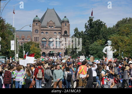 Toronto, Canada - September 27, 2019:  The Climate Strike attracted large crowds of young people in front of the Ontario Parliament