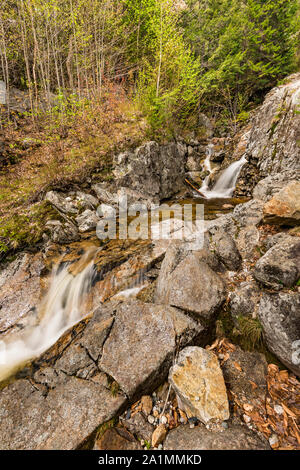 Lower tier of Silver Cascade in spring, White Mountain National Forest, Crawford Notch State Park, Carroll Co., NH - Stock Photo