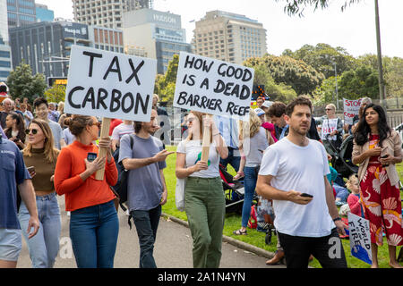 Sydney, young people holding signs and placards protestors against political inaction at the Sydney climate change strike rally,Sydney,Australia - Stock Photo