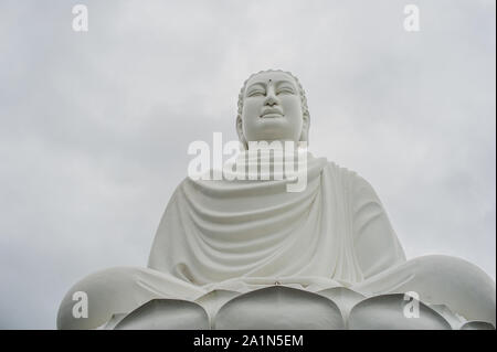 Big Buddha statue at the Long Son pagoda in Nha Trang Vietnam - Stock Photo