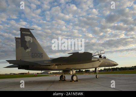 A U.S. Air Force F-15C Eagle from the Oregon Air National Guard's 173rd Fighter Wing, based in Klamath Falls, Oregon is parked outside the Air National Guard paint facility in Sioux City, Iowa on September 26, 2019. The aircraft was recently painted at the Iowa based ANG paint facility. The facility is a part of the Iowa Air Guard's 185th Air Refueling Wing maintenance group.  U.S. Air National Guard photo by Senior Master Sgt. Vincent De Groot - Stock Photo