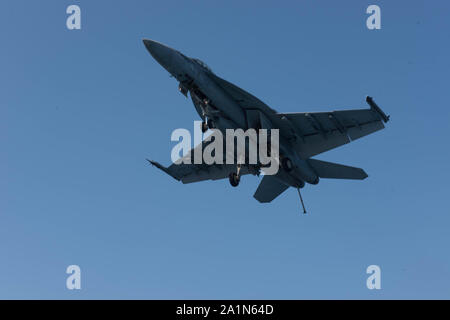 190926-N-XO654-2070  ATLANTIC OCEAN (Sept. 26, 2019) An F/A-18E Super Hornet, assigned to the 'Rampagers' of Strike Fighter Squadron (VFA) 83 prepares to land on the aircraft carrier USS Dwight D. Eisenhower (CVN 69). Ike, with embarked Carrier Air Wing 3, is underway conducting the Tailored Ship's Training Availability (TSTA) and Final Evaluation Problem (FEP) as part of the basic phase of the Optimized Fleet Response Plan. (U.S. Navy photo by Mass Communication Specialist Seaman Neadria Hazel) - Stock Photo