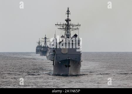 ATLANTIC OCEAN (Sept. 26, 2019) The Ticonderoga-class guided-missile cruiser USS San Jacinto (CG 56), the Dutch navy frigate HNLMS De Ruyter (F804),  the guided-missile destroyer USS Truxtun (DDG 103) and the Ticonderoga-class guided-missile cruiser USS Vella Gulf (CG 72) participate in a Group Sail exercise as part of Carrier Strike Group 10. CSG-10, also known as the Eisenhower CSG, is employed in a variety of roles, all of which involve gaining and maintaining sea control in an era of Great Power Competition. (U.S. Navy photo by LT Laura Radspinner/Released) - Stock Photo