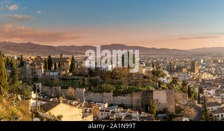 Aerial sunset panorama view of the Alhambra fortress and palace complex with surrounding medieval walls and towers in Granada Andalusia Spain - Stock Photo