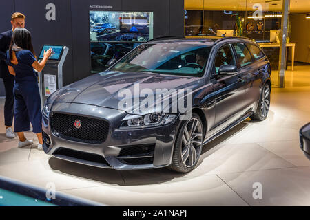 FRANKFURT, GERMANY - SEPT 2019: silver gray JAGUAR XF sedan, IAA International Motor Show Auto Exhibtion. - Stock Photo