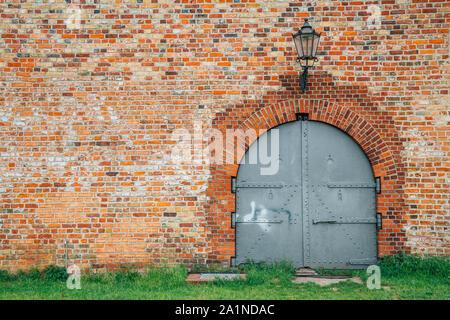 Brick wall and door on Spandau Citadel fortress in Berlin, Germany