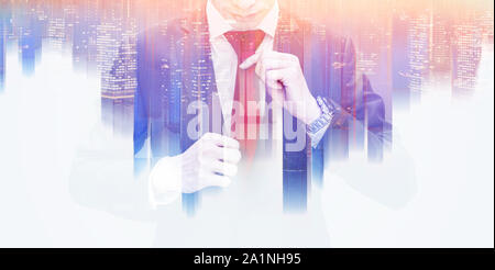 Double exposure businessman tying red necktie, and futuristic colorful city skyscraper - Stock Photo