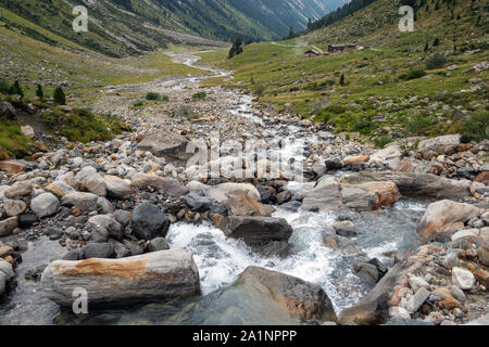 Alpine torrent. Krimmler Achental valley. Hohe Tauern National Park. Austrian Alps. - Stock Photo