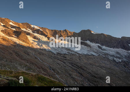 Krimmler Kees glacier. Seracs and crevasses. Sunset sunlight. Krimmler Achen valley. Hohe Tauern National Park. Austrian Alps. - Stock Photo