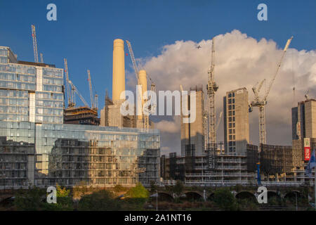 The construction site where gas tanks once stood next to Battersea Power Station on a sunny evening - Stock Photo