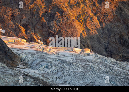 Krimmler Kees glacier. Seracs and crevasses. Sunset sunlight. Krimmler Achen valley. Hohe Tauern National Park. Austrian Alps. Glaciological aspects. - Stock Photo