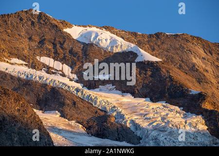 Krimmler Kees glacier. Seracs and crevasses. Sunset sunlight. Krimmler Achen valley. Hohe Tauern National Park. Austrian Alps. Glaciological aspects. - Stock Photo