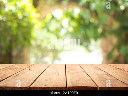 Empty wood table top on blur abstract green from garden and home area background.For montage product display or design key visual layout - Stock Photo