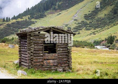Wooden chalet. Krimmler Achen valley. Hohe Tauern National Park. Austrian Alps. Europe.