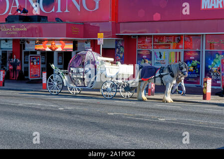 Blackpool promenade with horse carriage during an autumn weekend - one of Englands favorite seaside resorts. Photo taken on 19th of September 2019 - B - Stock Photo