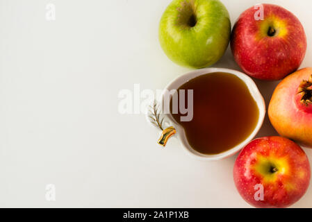 Fruits and honey health background. Apple, pomegranate and honey, traditional food of Jewish New Year - Rosh Hashana. Copy space background. Healthy food concept.Top view. - Stock Photo