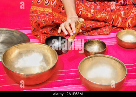 Tibetan singing bowl on the pink background - Stock Photo