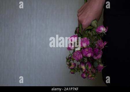 Woman holding old dry flowers. Unhappy love concept - Stock Photo