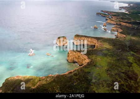 An air view over of some of the limestone stacks near the famous Twelve Apostles, facing the Southern Ocean along the Shipwreck coast in the Port Camp - Stock Photo