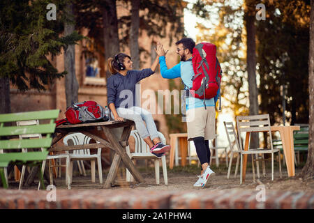 smiling couple preparing to continue travelling Stock Photo