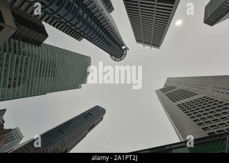 Skyscrapers viewed from below towards sky represents urban development with modern architecture, Singapore - Stock Photo