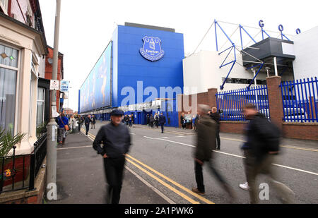 Fans arriving at the ground before the Premier League match at Goodison Park, Liverpool. - Stock Photo