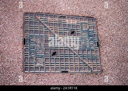 Manhole access cover in Southend on Sea, Essex, UK. Clun EN124 Load class D400 R&B ductile. Two part maintenance cover. Space for copy - Stock Photo