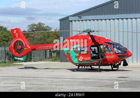 The Welsh Air Ambulance helicopter, based at Welshpool, awaits another mission. - Stock Photo
